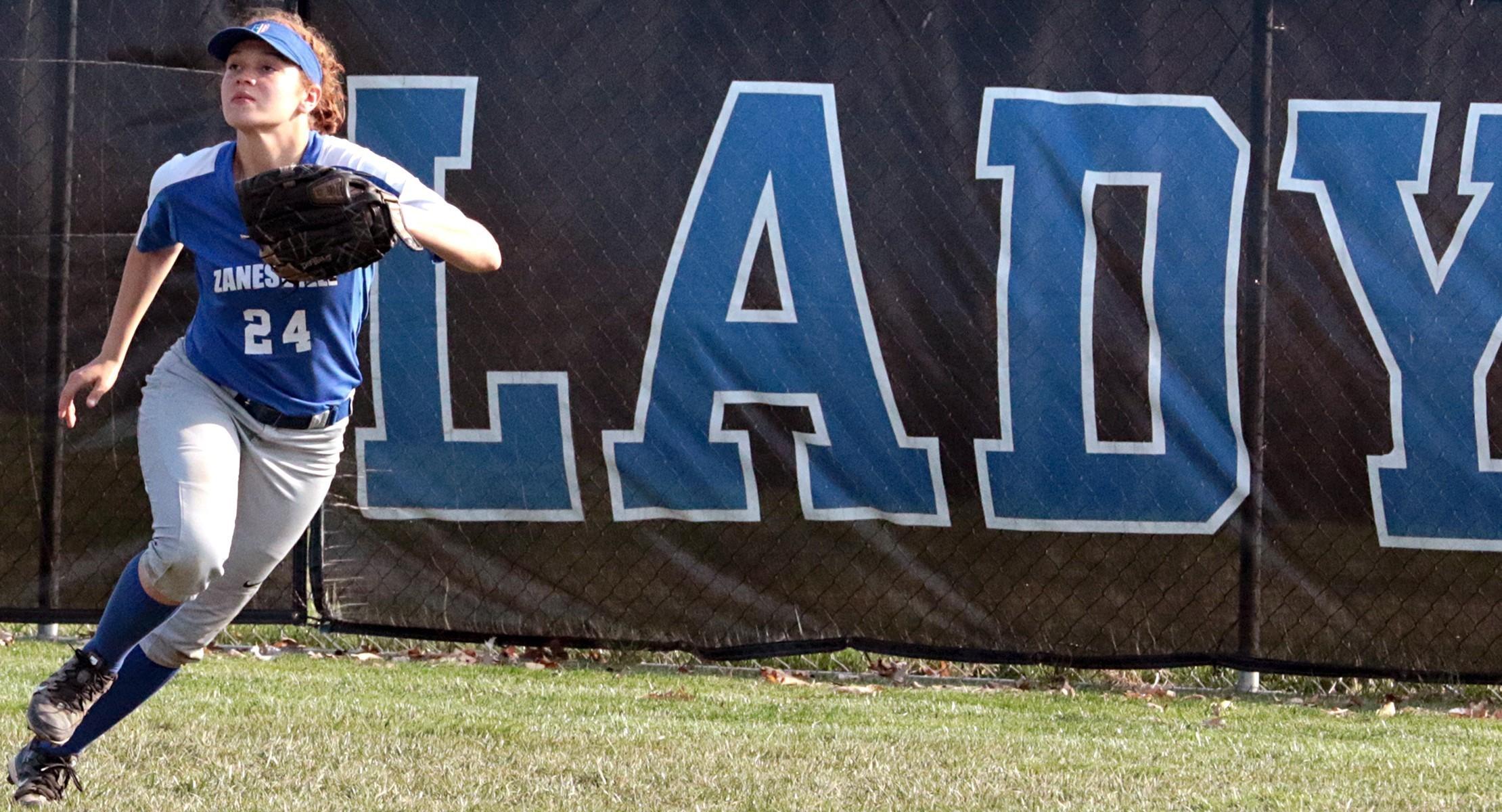 Softball outfielder running to catch the ball