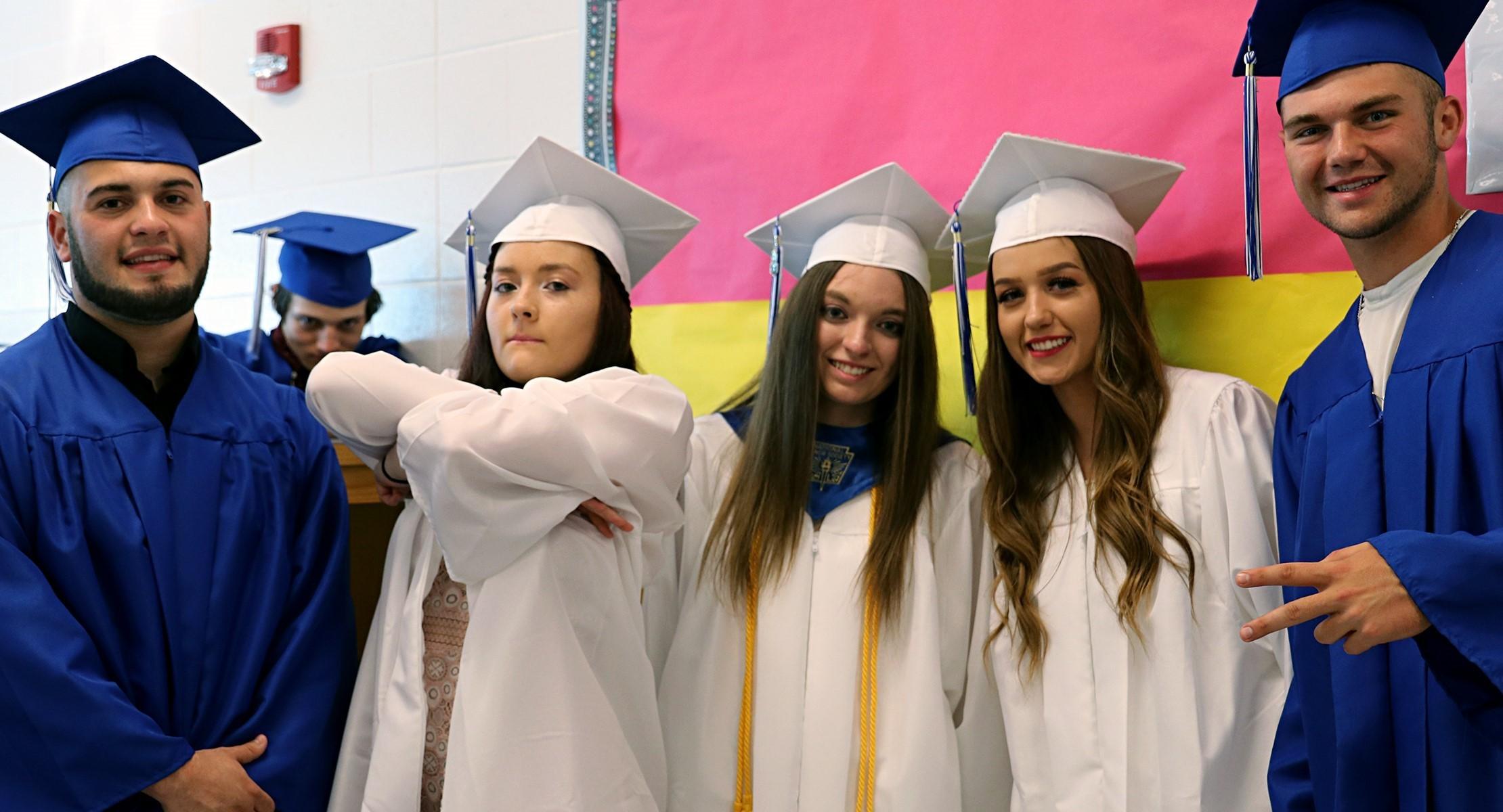 graduates smiling for camera